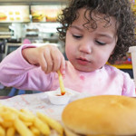 child eating junkfood