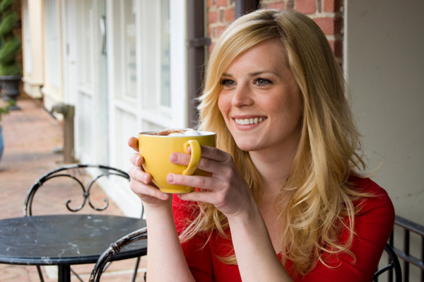 woman-drinking-coffee-in-cafe